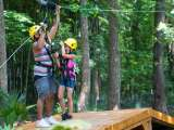 Guests exiting zipline at NC Zoo Air Hike ropes course