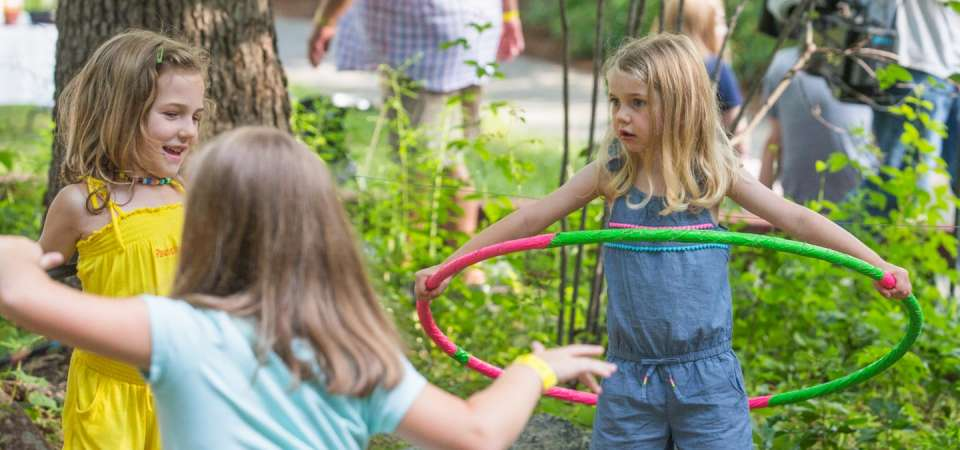 Children hoola hooping at special event